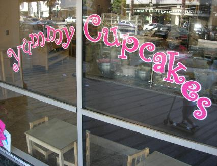 window lettering, hand lettering on windows - Yummy Cupcakes